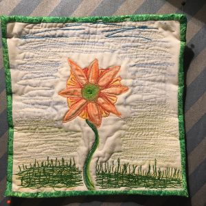 photo of my small flower UFO that is pinned and ready to have the binding stitched on. This is the one I don't have a strong WHY for.